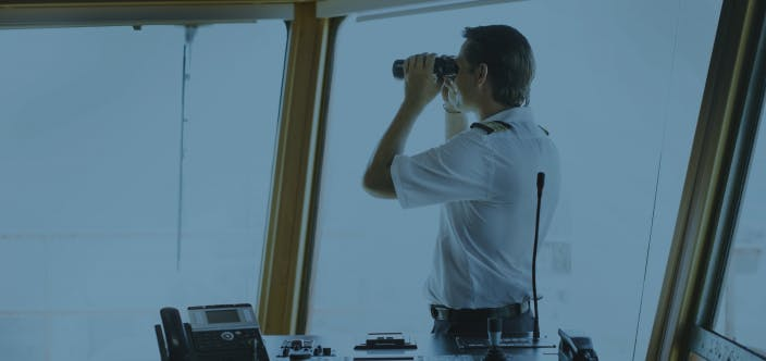 captain looking in a binocular
