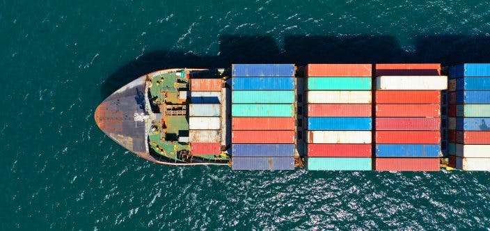 Aerial drone photo of industrial truck size container cargo ship_shutterstock_1726729180