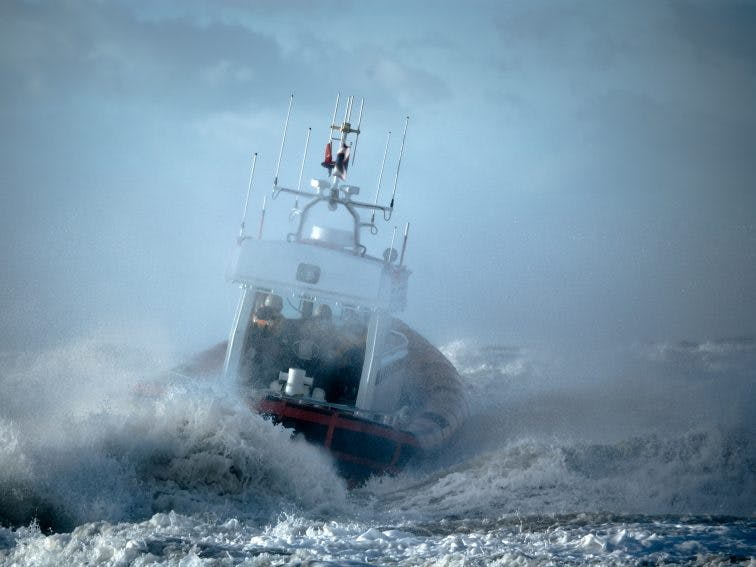 coast guard during storm in ocean shutterstock_4410715