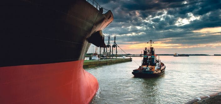 Tug boat taking out the ship from the harbor_shutterstock_62306698_newsp_200dpi