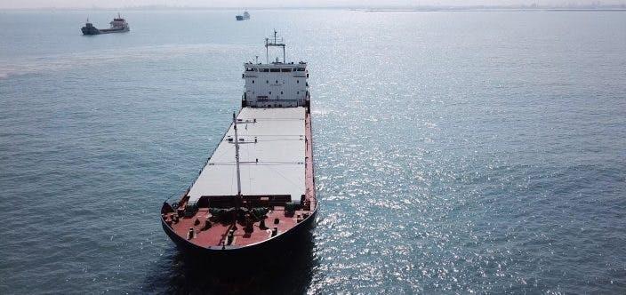 Large bulk carrier general cargo ship sailing / docking in open ocean_shutterstock_707658898