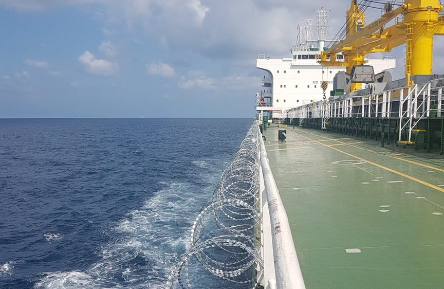 Razor,Wire,Fitted,On,Ship,Side,During,Passing,High,Risk