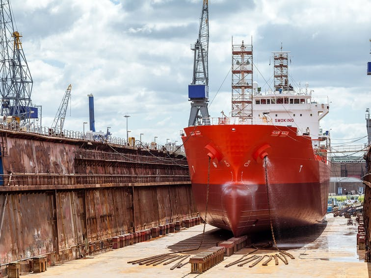 Floating dry dock with cranes in the port